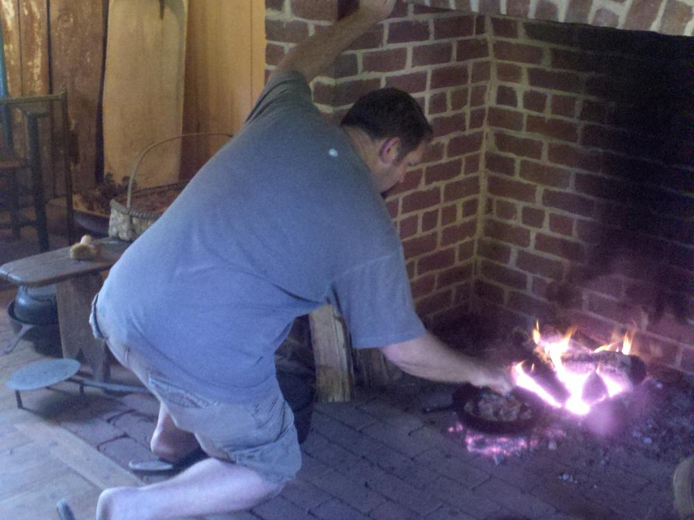 brian-davis-prepares-the-fire