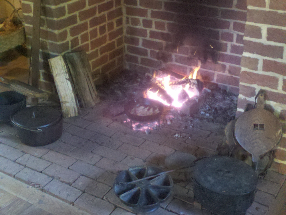 preparing-breakfast-in-the-hearth